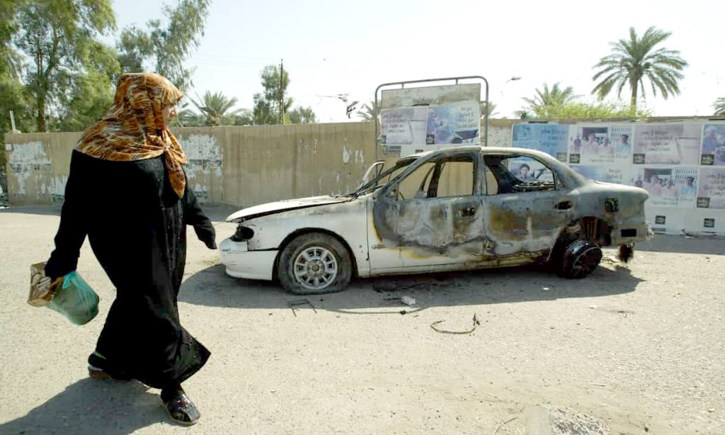 A burnt car on the site where Blackwater guards who were escorting US embassy officials opened fire in 2007